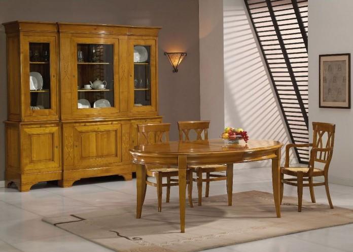 Table ovale chêne 4 pieds sabre finition verni